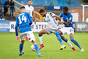 Macclesfield Town midfielder Emmanuel Osadebe tackles the opponent  during the EFL Sky Bet League 2 match between Macclesfield Town and Colchester United at Moss Rose, Macclesfield, United Kingdom on 28 September 2019.