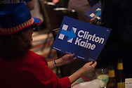 "A guest holds her ""Clinton Kaine"" poster during the Dallas County Democratic watch party in Dallas, Texas on November 8, 2016. (Cooper Neill for The Texas Tribune)"