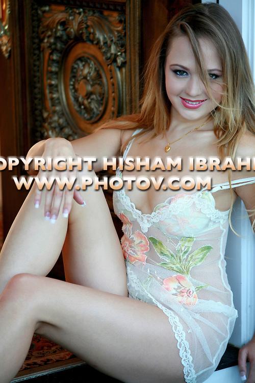 Beautiful sexy woman in lingerie sitting in doorway.