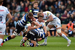 Luke Cowan-Dickie of Exeter Chiefs is tackled to ground by Ross Batty of Bath Rugby - Mandatory byline: Patrick Khachfe/JMP - 07966 386802 - 10/10/2015 - RUGBY UNION - The Recreation Ground - Bath, England - Bath Rugby v Exeter Chiefs - West Country Challenge Cup.