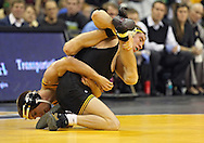 December 8, 2011: Iowa Hawkeyes Matt McDonough and Northern Iowa Panthers Cruse Aarhus battle for control in the 125 pound bout of the NCAA wrestling dual between the Northern Iowa Panthers and the Iowa Hawkeyes at Carver-Hawkeye Arena in Iowa CIty, Iowa on Thursday, December 8, 2011. McDonough defeated Aarhus 10-1 and Iowa defeated Northern Iowa 38-4.