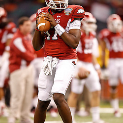 January 4, 2011; New Orleans, LA, USA;  Arkansas Razorbacks quarterback Brandon Mitchell (17) during warm ups prior to kickoff of the 2011 Sugar Bowl against the Ohio State Buckeyes at the Louisiana Superdome.  Mandatory Credit: Derick E. Hingle
