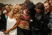 Pamela Anderson, Suzy Sioux ,Stella McCartney and Fernanda Tavarez,  PETA's Humanitarian Awards, Stella McCartney, Bruton Street, London, W1. 28 June 2006. ONE TIME USE ONLY - DO NOT ARCHIVE  © Copyright Photograph by Dafydd Jones 66 Stockwell Park Rd. London SW9 0DA Tel 020 7733 0108 www.dafjones.com