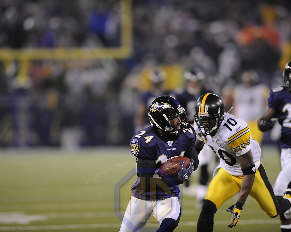 30 December 2007:  Baltimore Ravens cornerback David Pittman (24) makes his second interception of the game on a pass intended for Pittsburgh Steelers wide receiver Santonio Holmes (10) thrown by quarterback Charlie Batch to end a drive late in the 4th quarter on December 30, 2007 at M&T Bank Stadium in Baltimore, Maryland. The Ravens defeated the Steelers 27-21.