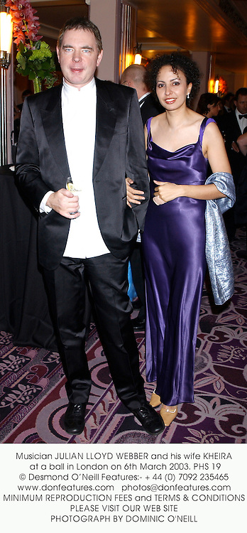 Musician JULIAN LLOYD WEBBER and his wife KHEIRA at a ball in London on 6th March 2003.PHS 19