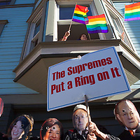 Activists dressed as members of the US Supreme Court stand along San Francisco's Dyke March parade route as bystanders wave pride flags in San Francisco, CA, June 29, 2013. The Supreme Court recently overturned California's Proposition 8 – a ban on same-sex marriages.