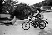 Symond and Neville on Motorbike, High Wycombe, UK, 1980s.
