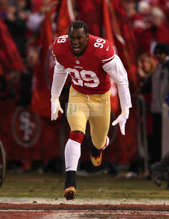 San Francisco 49ers outside linebacker Aldon Smith (99) is introduced during a NFL Divisional playoff game against the Green Bay Packers at Candlestick Park in San Francisco, Calif., on Jan. 12, 2013. The 49ers defeated the Packers 45-31. (AP Photo/Jed Jacobsohn)