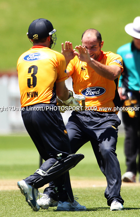 Wellington's Luke Woodcock celebrates dismissing Graham Napier with keeper Chris Nevin.<br /> One Day cricket - Wellington Firebirds v Central Stags at Allied Nationwide Finance Basin Reserve, Wellington. Thursday, 17 December 2009. Photo: Dave Lintott/PHOTOSPORT