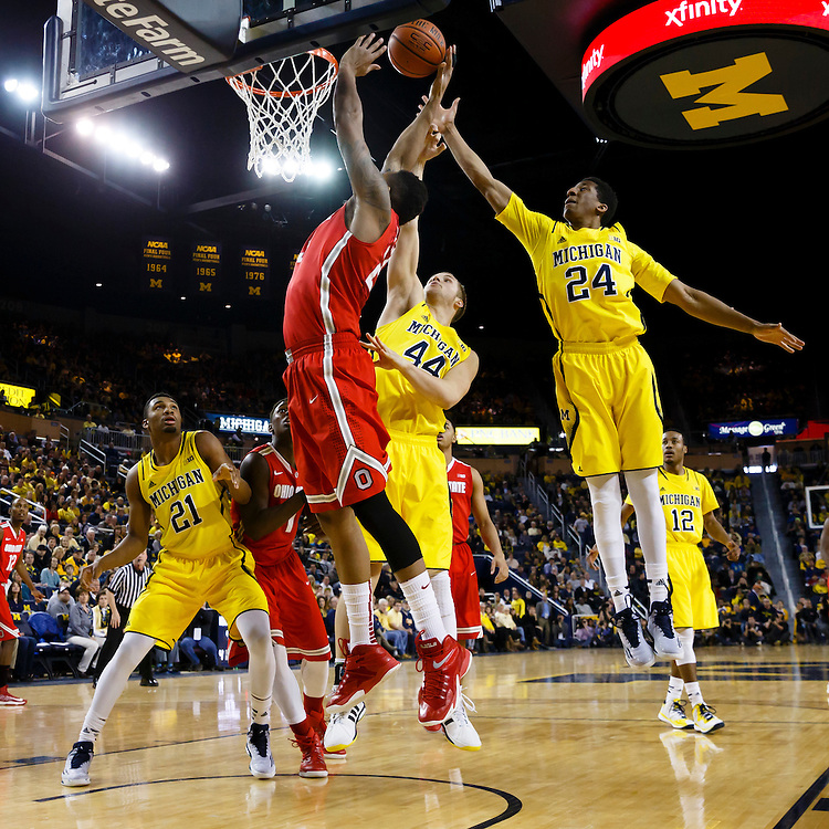Feb 22, 2015; Ann Arbor, MI, USA; Ohio State Buckeyes center Amir Williams (23) is fouled by Michigan Wolverines forward Max Bielfeldt (44) in the second half at Crisler Center. Michigan won 64-57. Mandatory Credit: Rick Osentoski-USA TODAY Sports