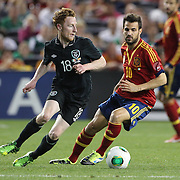 Stephen Quinn, Ireland, (left) and Cesc Fabregas, Spain, in action during the Spain V Ireland International Friendly football match at Yankee Stadium, The Bronx, New York. USA. 11th June 2013. Photo Tim Clayton