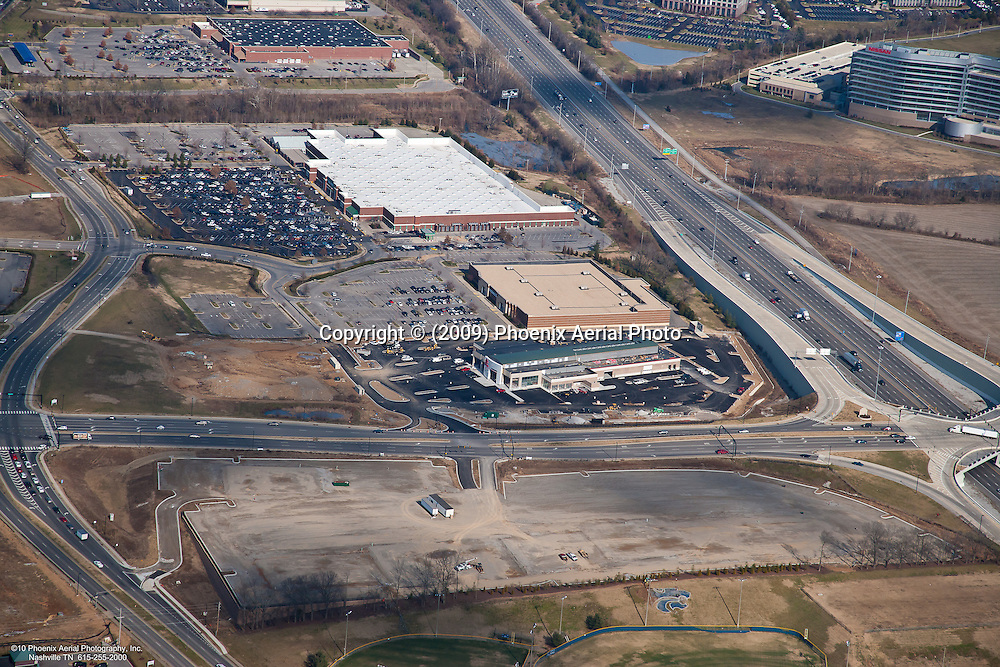 Aerial photo of the I-65 and McEwen Drive intersection in CoolSrpings showing Alexander Toyota, Kohl's, Walmart, Sam's and Nissan headquarters in the background.