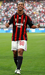 AC Milan's Brazilian forward Ronaldinho celebrates after scoring his second goal against Sampdoria during their Italian Serie A match on October 19, 2008 at San Siro Stadium in Milan.