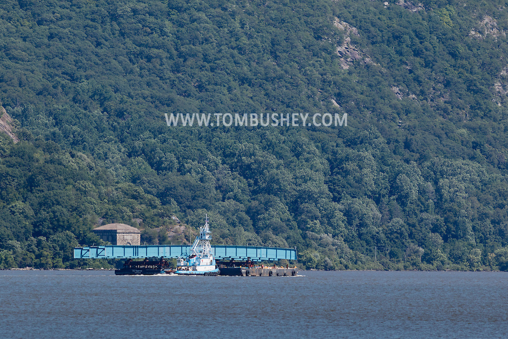 New Windsor, New York - The tugboat Ocean Tower pushes a barge carrying a piece of the new Tappan Zee bridge south on the Hudson River as seen from Plum Point on July 31, 2015.