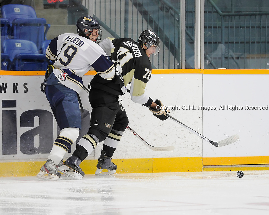 TRENTON, ON - Nov 8 : Ontario Junior Hockey League Game Action between Trenton Golden Hawks and Toronto Lakeshore Patriots, Matthew McLeod #19 of the Toronto Patriots Hockey Club tries to get the from Nick Santoro of the Trenton Golden Hawks Hockey Club<br /> (Photo by Amy Deroche / OJHL Images)