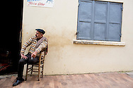Man takes a break in front of his shop in Tire, Turkey April, 2013