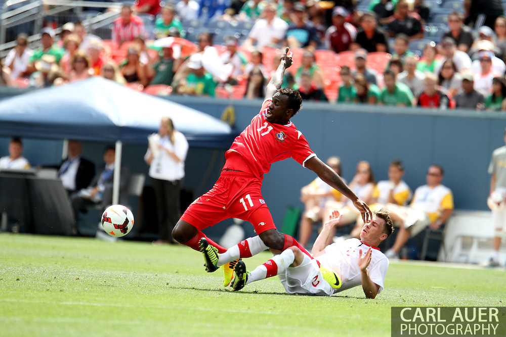 July 14 2013:  Panama Forward Cecilio Waterman (11) is taken down from behind by Canada Defender Nikolas Ledgerwood (2) during the second half of the CONCACAF Gold Cup soccer match between Panama and Canada at Sports Authority Field in Denver, CO. USA.