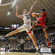 SIU-Edwardsville guard Tre Harris, right, passes around Purdue forward Matt Haarms  in the first half of an NCAA college basketball game in West Lafayette, Ind., Friday, Nov. 10, 2017.