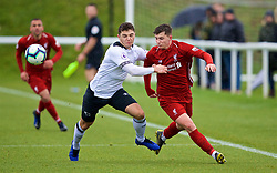 DERBY, ENGLAND - Friday, March 8, 2019: Liverpool's Ben Woodburn (R) and Derby County's Ethan Wassall (L) during the FA Premier League 2 Division 1 match between Derby County FC Under-23's and Liverpool FC Under-23's at the Derby County FC Training Centre. (Pic by David Rawcliffe/Propaganda)