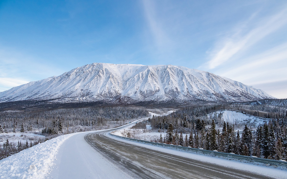 Haines Highway and Kluane National Park near the Takhanne River in Yukon Territory, Canada. Winter. Afternoon.