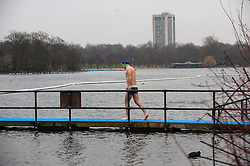 Members of the Serpentine Swimming Club brave the cold for an early morning swim, London, UK, 25 March, 2013. Photo by: i-Images..