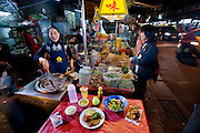 Lin Hui-wen, a street food vendor, with her typical day's worth of food at night market in Taipei, Taiwan. (From the book What I Eat: Around the World in 80 Diets.) MODEL RELEASED.