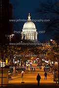 The illuminated dome of the Wisconsin State Capitol glows while silhouetted people walk along State Street, a pedestrian mall, as dusk falls over downtown Madison, Wis., on Oct. 12, 2007..Photo © Jeff Miller 2007 - all rights reserved.www.jeffmillerphotography.com  ?  608-250-2374.Date: 10/07   File#: NIKON D200 digital camera frame 4179