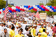 10 APRIL 2006 - PHOENIX, AZ: More than 125,000 people participated in a march for immigrants's rights in Phoenix Monday. The march was a part of a national day of action on behalf of undocumented immigrants. There were more than 100 such demonstrations across the US Monday. Protestors were encouraged to wear white, to symbolize peace, and wave American flags, to demonstrate their patriotism to the US.  Photo by Jack Kurtz