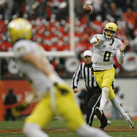 Oregon quarterback Marcus Mariota fires a pass to a receiver in the third quarter during the Ducks' 48-24 victory over Oregon State in the 116th annual Civil War game on Saturday Nov. 24, 2012.