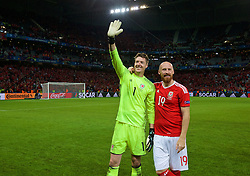 LILLE, FRANCE - Friday, July 1, 2016: Wales' goalkeeper Wayne Hennessey and James Collins celebrate after a 3-1 victory over Belgium and reaching the Semi-Final during the UEFA Euro 2016 Championship Quarter-Final match at the Stade Pierre Mauroy. (Pic by David Rawcliffe/Propaganda)