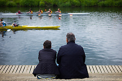 © Licensed to London News Pictures.13/06/15<br /> Durham, England<br /> <br /> A couple watch the racing during the 182nd Durham Regatta rowing event held on the River Wear. The origins of the regatta date back  to commemorations marking victory at the Battle of Waterloo in 1815. This is the second oldest event of this type in the country and attracts over 2000 competitors from across the country.<br /> <br /> Photo credit : Ian Forsyth/LNP