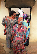 Local women help to search for the body of an old woman  at the hamlet of Shoboshobane, on the KwaZulu/Natal South Coast.  On Christmas Day, the ANC village was attacked by Inkatha neighbours killing more than 20 residents, and driving the rest into refugee camps.  December 26th, 1995.