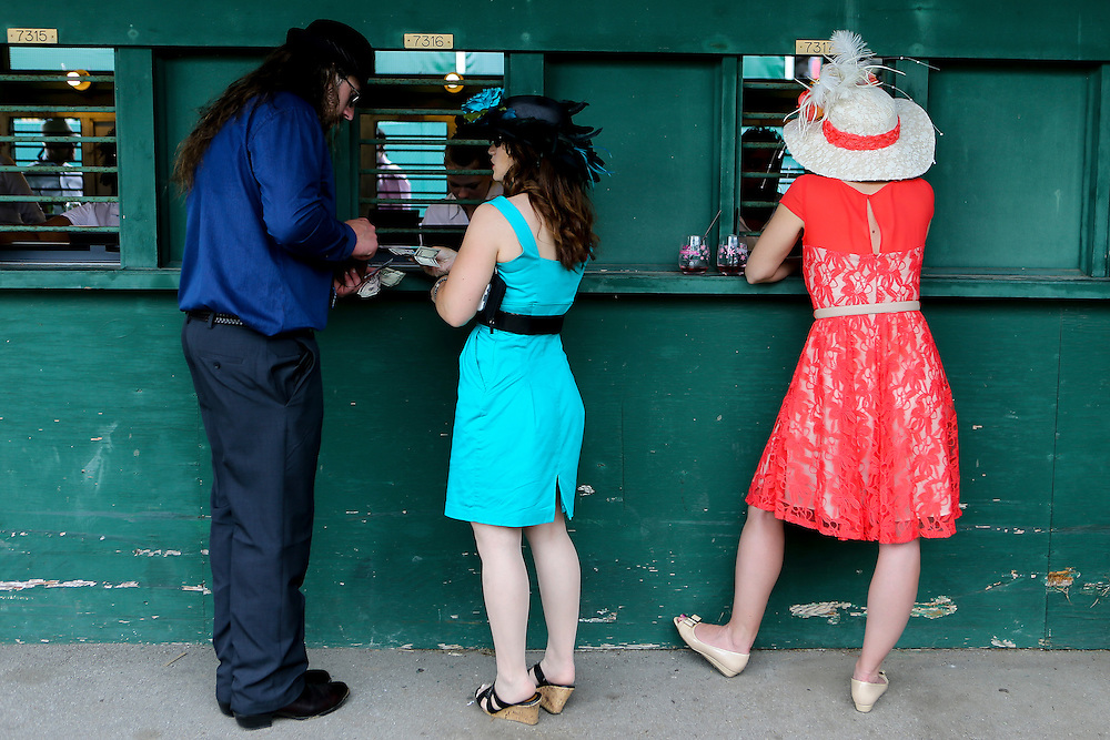 LOUISVILLE, KY - MAY 7:   Fans place bets prior to the 142nd running of the Kentucky Derby at Churchill Downs on May 7, 2016 in Louisville, Kentucky. (Photo by Michael Reaves/Getty Images)