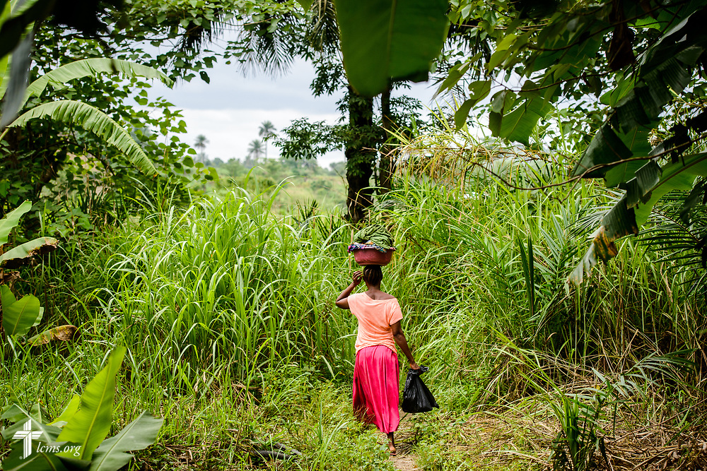 A woman leaves the clinic on the third day of the LCMS Mercy Medical Team on Wednesday, May 9, 2018, in the Yardu village outside Koidu, Sierra Leone, West Africa. LCMS Communications/Erik M. Lunsford