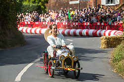Cookham Dean, UK. 1 September, 2019. A custom-built kart in the form of Chitty Chitty Bang Bang competes in the Cookham Dean Gravity Grand Prix in aid of the Thames Valley and Chiltern Air Ambulance.