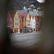 Noorwegen Bergen 30 december 2008 20081230 Foto: David Rozing .Havenstad Bergen, unesco world heritage site Bryggen  .Bryggen is de kade van de oude haven van de hanze stad Bergen. Rond de 13e eeuw werd Bergen een van de hanzesteden. Hierdoor ontstond veel handel met andere landen. Het centrum hiervan was de kade van de haven. De naam hiervoor is Bryggen. .In de 14e eeuw stonden hier zo'n 30 huizen die gedeeld werden door diverse handelsfirma's. De huizen zijn diverse keren afgebrandt en opnieuw opgebouwd. Sinds 1980 staan 58 houten gebouwen op de Unesco World Heritage lijst. .The city of Bergen, unesco world heritage site Bryggen .Bryggen, the old wharf of Bergen, is a reminder of the town's importance as part of the Hanseatic League's trading empire from the 14th to the mid-16th century. Many fires, the last in 1955, have ravaged the characteristic wooden houses of Bryggen. Its rebuilding has traditionally followed old patterns and methods, thus leaving its main structure preserved, which is a relic of an ancient wooden urban structure once common in Northern Europe. Today, some 62 buildings remain of this former townscape...Foto: David Rozing