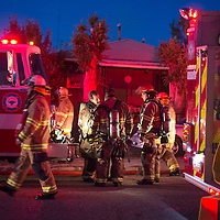 Firefighters with the McKinley County Fire Department respond to the scene of a house fire on the North side of Gallup off Jefferson Avenue near Strong Drive Tuesday.