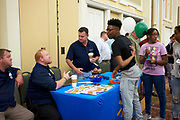 Students interact with representatives from Walmart.