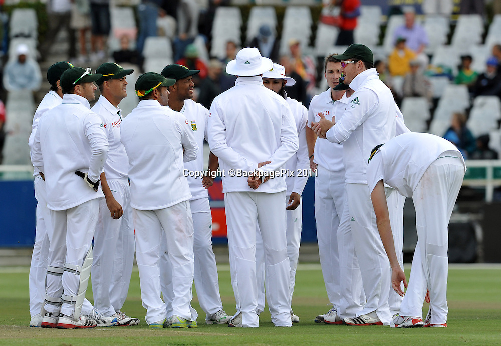Graeme Smith (captain of South Africa) chats to his players after Dale Steyn had taken the wicket of Shaun Marsh of Australia. South Africa v Australia, first test, day 1, Newlands, South Africa. 9 November 2011.<br /> <br /> &copy;Ryan Wilkisky/BackpagePix