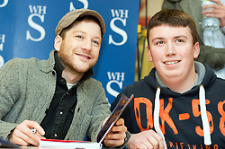 "X Faxtor 2010 Winner Matt Cardle signs copies of his book ""Matt Cardle My Story"" at WH Smith branch in Meadowhall Shopping Centre Sheffield Lunchtime on Wednesday 2 March 2011.Images © Paul David Drabble"