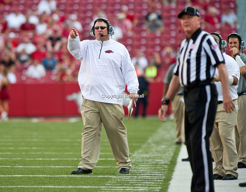 Aug 31, 2013; Fayetteville, AR, USA; Arkansas Razorback head coach Bret Bielema reacts to a play during the second half of a game against the Louisiana Ragin' Cajuns at Donald W. Reynolds Razorback Stadium. Arkansas defeated Louisiana 34-14. Mandatory Credit: Beth Hall-USA TODAY Sports