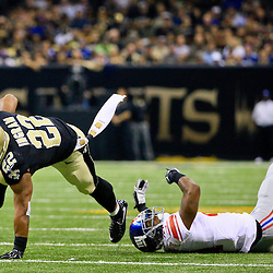 Nov 1, 2015; New Orleans, LA, USA; New Orleans Saints running back Mark Ingram (22) breaks a tackle by New York Giants cornerback Dominique Rodgers-Cromartie (41) during the first quarter of a game at the Mercedes-Benz Superdome. Mandatory Credit: Derick E. Hingle-USA TODAY Sports