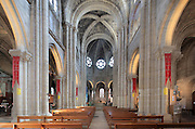 Nave of the Collegiale Notre-Dame de Poissy, a catholic parish church founded c. 1016 by Robert the Pious and rebuilt 1130-60 in late Romanesque and early Gothic styles, in Poissy, Yvelines, France. The nave was reworked in the 15th and 16th centuries and has bays on both sides leading to the side aisles. Saint Louis was baptised here in 1214. The Collegiate Church of Our Lady of Poissy was listed as a Historic Monument in 1840 and has been restored by Eugene Viollet-le-Duc. Picture by Manuel Cohen