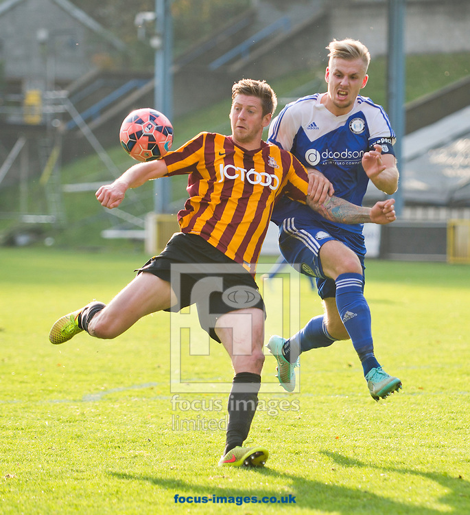 Jonathan Stead of Bradford City looks to shoot at goal as Marc Roberts of FC Halifax Town closes down during the The FA Cup match at Shay Stadium, Halifax<br /> Picture by Russell Hart/Focus Images Ltd 07791 688 420<br /> 09/11/2014