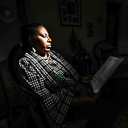 Former UD professor Arica Coleman reads correspondence  from the University of Delaware at her home Wednesday. Feb. 27, 2019, in Newark, DE. <br /> <br /> Former UD professor was denied tenure. She believes it was discriminatory