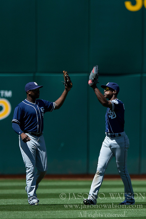 OAKLAND, CA - JUNE 18:  Justin Upton #10 of the San Diego Padres celebrates with Melvin Upton Jr. #2 after the game against the Oakland Athletics at O.co Coliseum on June 18, 2015 in Oakland, California. The San Diego Padres defeated the Oakland Athletics 3-1. (Photo by Jason O. Watson/Getty Images) *** Local Caption *** <br /> Justin Upton; Melvin Upton Jr.