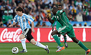 Argentina's forward Lionel Messi (L) controls the ball past Nigeria's defender Nwankwo Kanu during the World Cup South Africa 2010 soccer match, at Soccer City stadium, in Johannesburgo, South Africa, on June 12, 2010.  (Alejandro Pagni/PHOTOXPHOTO)
