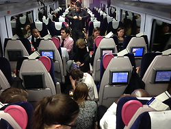 © Licensed to London News Pictures. 24/10/2014. London, UK. Rail passengers sit on a crowded stationary delayed Paddington-Swansea rush hour rail service, the stoppage being caused by a person struck by a train in the West Drayton area.  The train has been forced to return back to Paddington with the service cancelled.  Photo credit : Richard Isaac/LNP