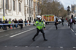 London, March 22nd 2017. A police officer cordons off Whitehall in the aftermath of a shooting incident on Westminster Bridge, where several pedestrians were also mown down by a car.