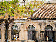 17 MARCH 2015 - BANGKOK, THAILAND: A wing of the old Customs House in Bangkok. The old Customs House was once the financial gateway to Thailand (before 1932 called Siam). It was designed by an Italian architect in the 1880s. In the 1950s, customs moved to new, more modern building and the Customs House became the headquarters for the Marine firefighters. The firefighters now live in the decrepit buildings with their families.    PHOTO BY JACK KURTZ